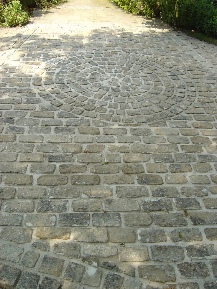 Cobblestone walkway with circle design.                              …