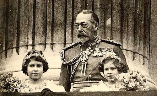 King George V with his granddaughters, Princess Elizabeth, now Queen Elizabeth II, and Princess Margaret.