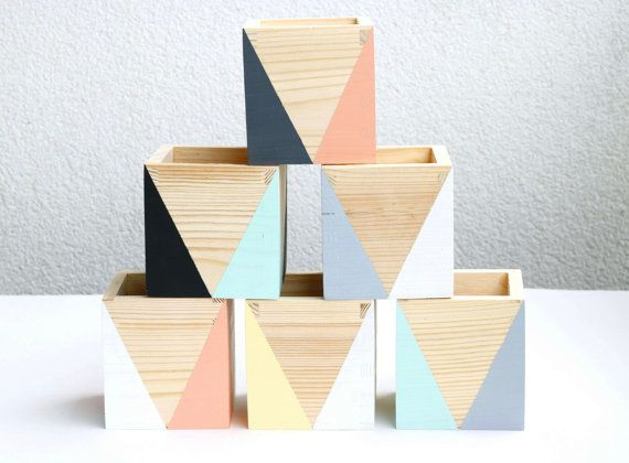 Organise your desk with these wooden storage pots. Geometric shapes and colours will brighten up any desk wherever you go. Love, Flexiworkforce.