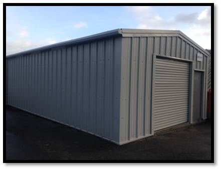 Steel Framed Building, In Goose Wing Grey Colour With One Roller Shutter  Door And One