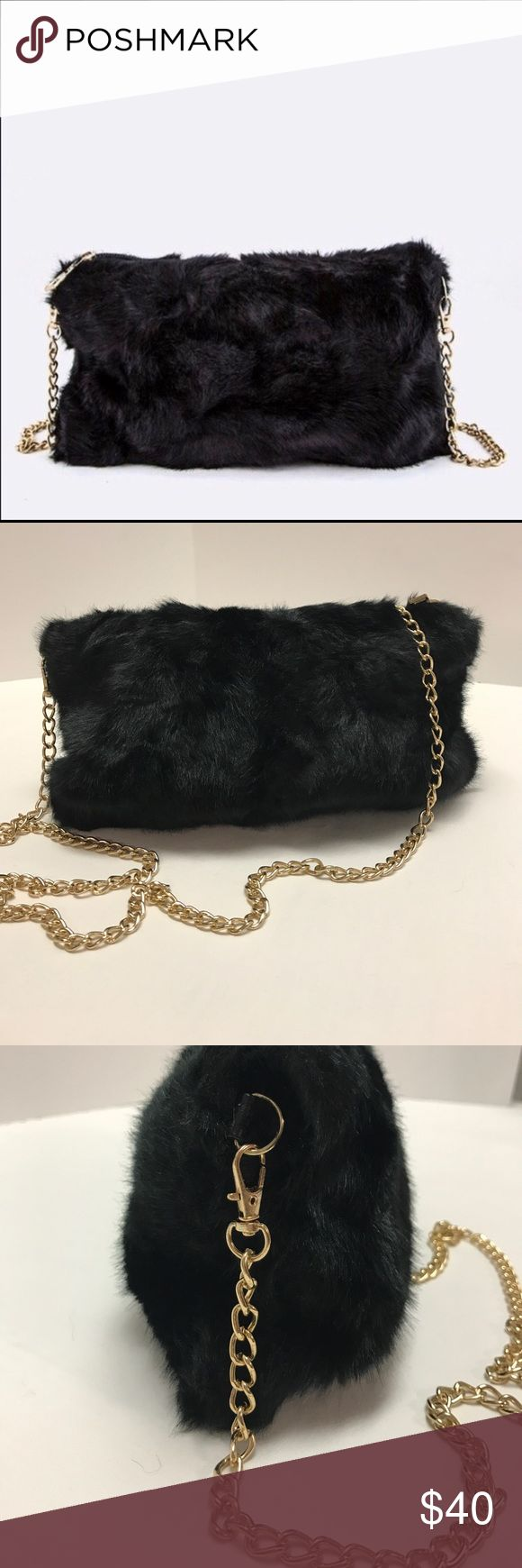 """Faux Fur Crossbody With Chain Strap This fun little purse is super fun and just the right size for a night on the town!  The faux fur is made of a poly/acrylic blend that should be hand washed & air dried  to ensure it retains its finish.  The bag has a top zipper closure in gold finished hardware and is lined with black satin. The strap is a gold finished chain that has a 22"""" drop and is removable if you would like to carry the bag as a clutch.  The dimensions of the bag are approx. 10""""W x…"""