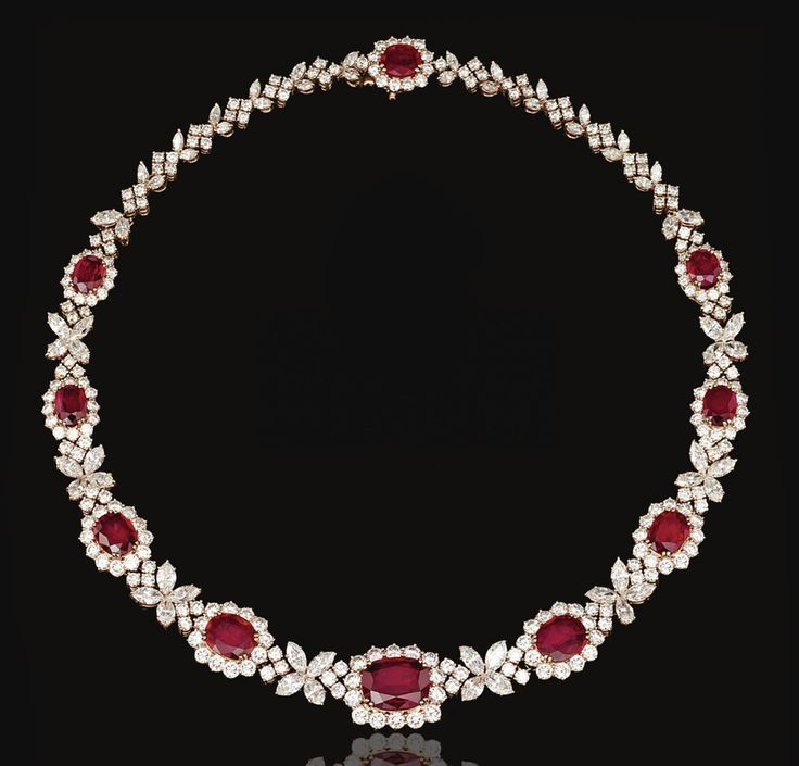 RUBY AND DIAMOND NECKLACE, HARRY WINSTON.  Designed as a series of graduated oval rubies bordered by brilliant-cut diamonds, alternating with quatrefoil motifs set with marquise-shaped stones, to a clasp of similar design, mounted in in yellow gold, length approximately 395mm,  signed Winston, maker's marks and numbered.