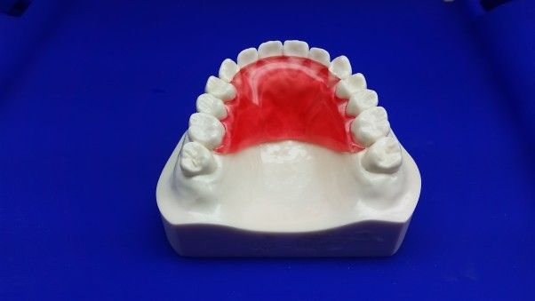 Hawley Retainer- Clear Red.....The Hawley Retainer is the most popular retainer that orthodontists use when they remove a patient's braces......Price:$169(Single) & $199(Set)