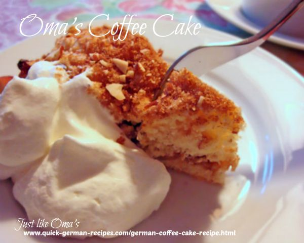 Piece of German Coffee Cake with whipped Cream. http://www.quick-german-recipes.com/german-coffee-cake-recipe.html is one of many recipes to try.