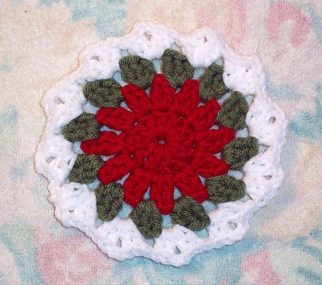 Crocheted Christmas Coaster. Here's the link to the pattern: http://www.ravelry.com/patterns/library/free-smoothfoxs-holiday-coaster