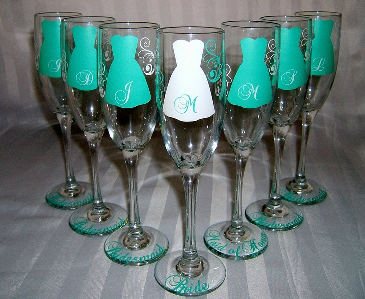 7 Personalized Bride and Bridesmaid Champagne Glasses, Wedding Party Glasses. $84.00, via Etsy.