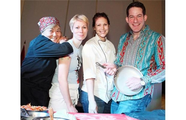 From left, Ottawa chefs Caroline Ishii, Sarah Allen and Katie Brown with emcee Stuntman Stu at the Red & White fundraiser for Harmony House, held Wednesday, Jan. 16, 2013, at Ashbury College.