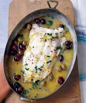Roasted Pacific Cod with Olives & Lemon ~ 2   pounds   Pacific cod or some other white fish fillets (such as halibut)     3/4   cup   dry white wine (such as Sauvignon Blanc)     1/2   cup   mixed olives       zest from 1 lemon, cut into strips     1   tablespoon   olive oil       kosher salt and pepper     1/4   teaspoon   red pepper flakes     1/4   cup   fresh flat-leaf parsley, chopped