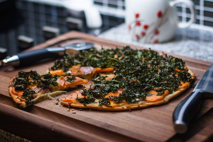Sweet Potato Pizza     1 pizza crust     1 medium sweet potato, sliced thinly     ½ red onion, sliced     1 tablespoon olive oil     salt & pepper to taste     ½ mozzarella ball, grated     3 cups kale, chopped in ribbons     2 tablespoons balsamic vinegar