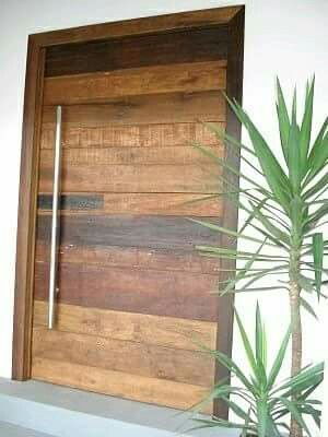 This pivot door combines rustic wood and modern design in a fun and unique way! Find out more about pivot doors or design your own at https://pivotdoorcompany.com/Exterior-Doors/.