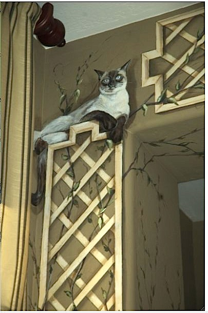 Hand painted mural of trellis with unexpected cat. Carmenillustrates.com