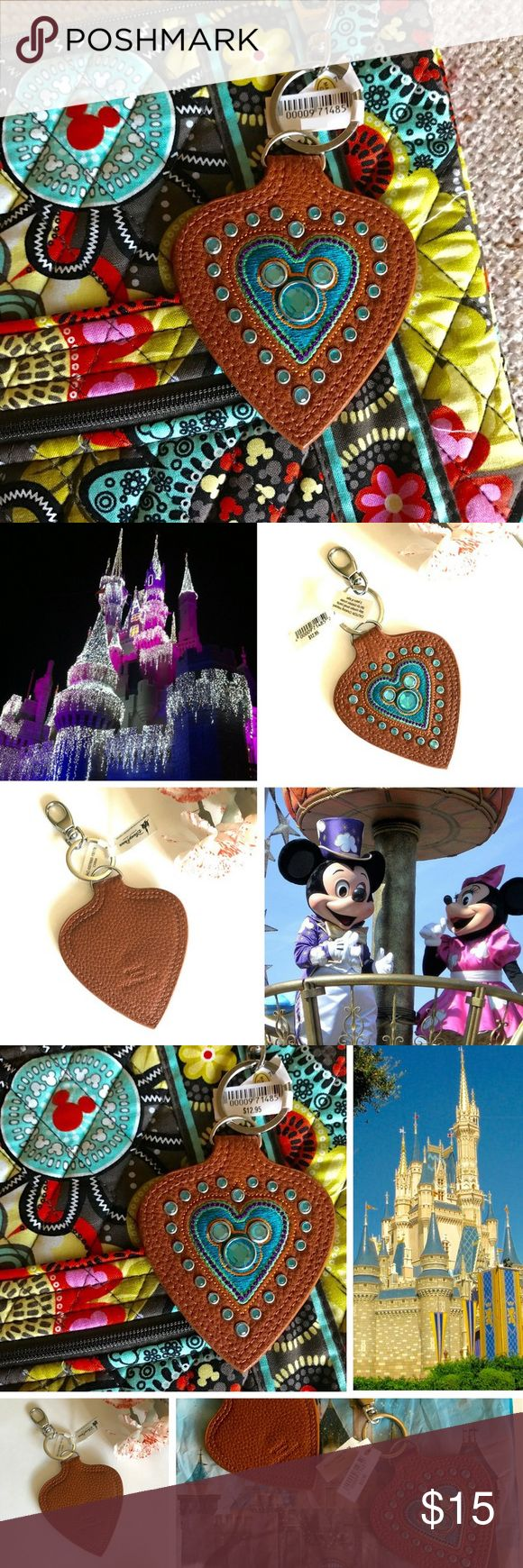 """🆕 Disney 💛 keychain - hard to find! Magically, adorably practical! This handy ❤️ keychain is so pretty with rhinestone detail, colored stitching and embroidery work – a heart frames Mickey ears on the front. Back: tan leather (?) grain with double stitching. Sturdy key ring with handy clip to adorn your bag. Rare – hard to find! NWT, never used. 2 available, price per keychain - bundle to save!  ❤️Size: approx 3"""" wide heart, total dangles 6"""" long 💚Imported 💛Authentic Disney Parks…"""