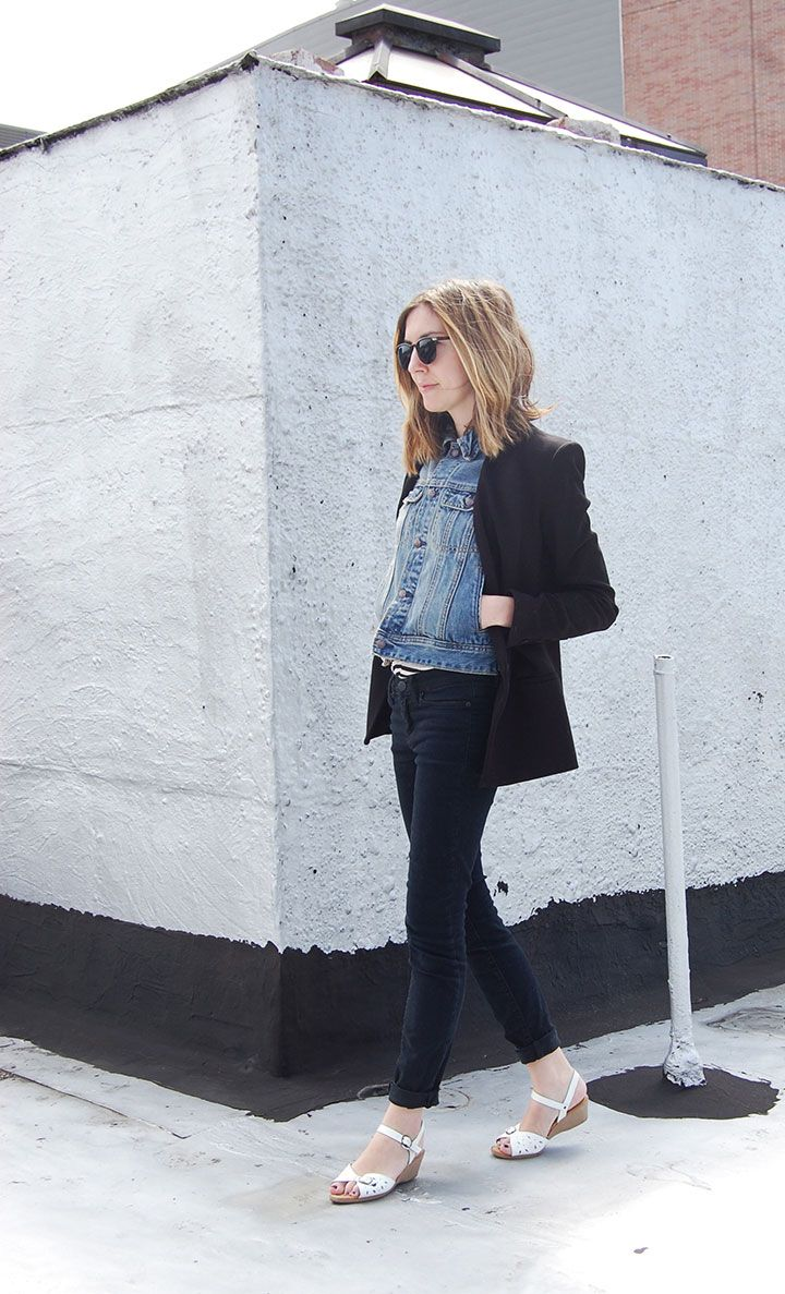denim jacket or vest with structured black blazer on top, skinny black jeans, simple sandals | StyleCaster
