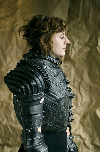 Joan of Arc suit of armor constructed from paper mache'd cardboard, and covered entirely in bicycle tubes that have been stretched, woven, piped, and cut in various ways. www.graceduval.com