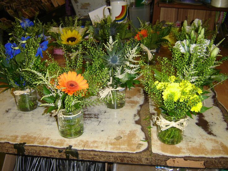 Flowers in jam jars for tables