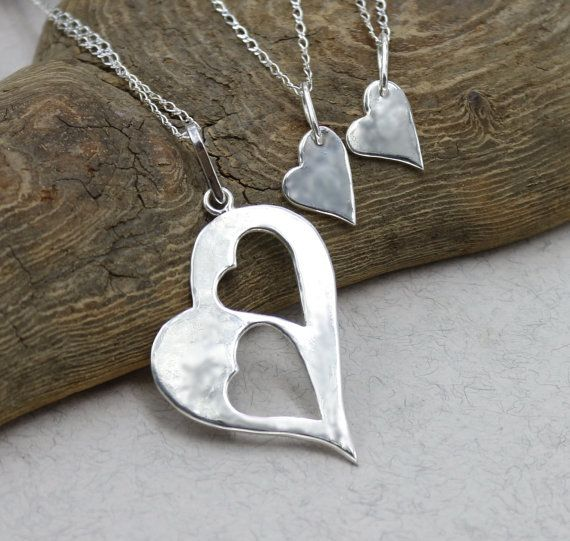 Mother Daughter Heart Necklace Set . This set of three separate sterling silver necklaces - one Mom necklace features a large sterling silver heart pendant with a cut-out hearts and the other two daughters necklaces features a small sterling silver hearts charm. The perfect Mom
