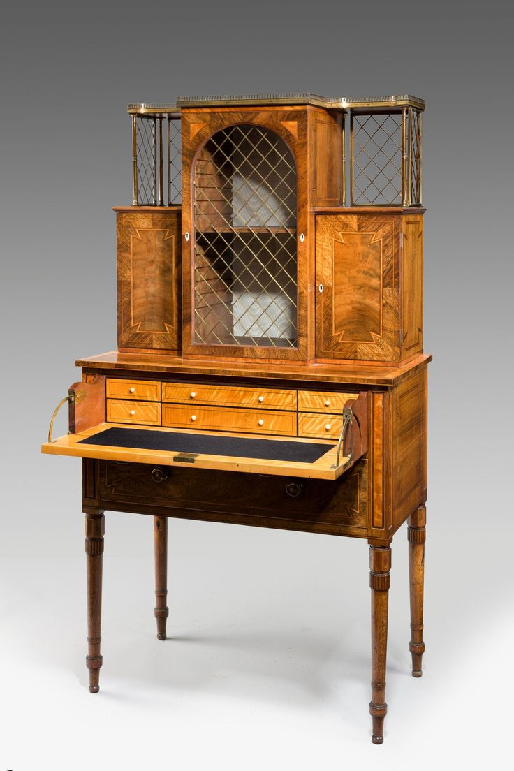 Regency Rosewood and Satinwood Lady's Secretaire Display Cabinet The cabinet veneered in rosewood, mahogany and satinwood with tulipwood cross banding strung with boxwood and ebony in a somewhat eccentric and unusual pattern at the angles. The entire cabinet is in a very fine state of originality and of neat and compact dimensions.