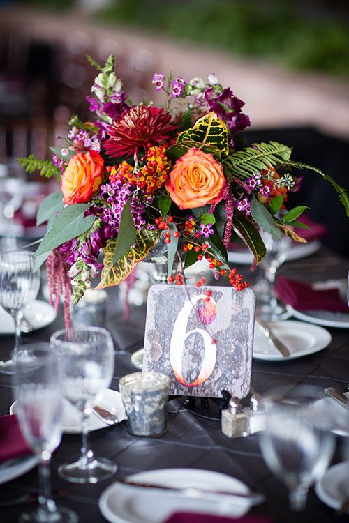 Colorful Fall Wedding in Pennsylvania, Purple and Orange Floral Centerpieces with Wooden Table Numbers | Brides.com