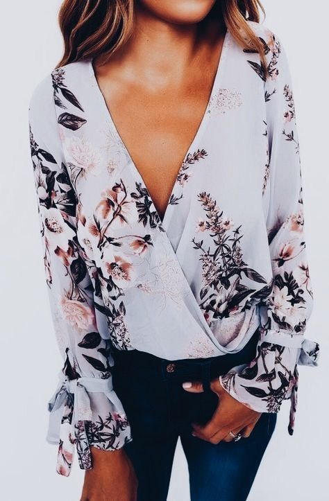 Pretty floral blouse with jeans.