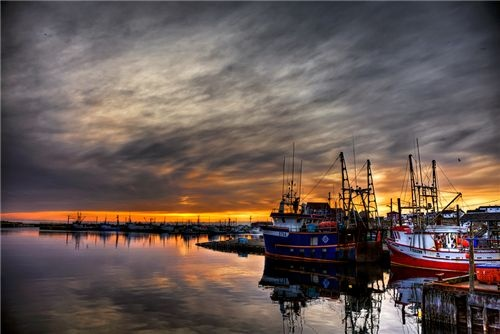 A shot of the wharf in Bonavista, Newfoundland just as the sun was at its final stage of setting.