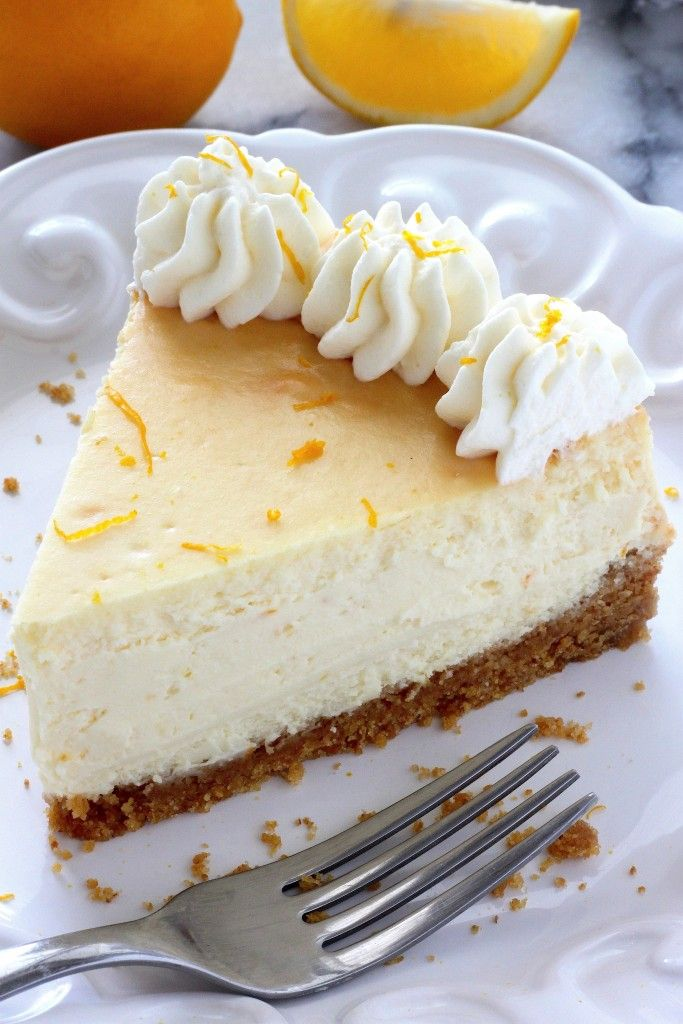 Lemon Ricotta Cheesecake - Rich, Creamy, and SO easy to make with everyday ingredients! This will be a hit on any dessert table!