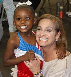 At Aim High Academy's Gold Medal Night - Mary Lou Retton with one of our little gymnasts.