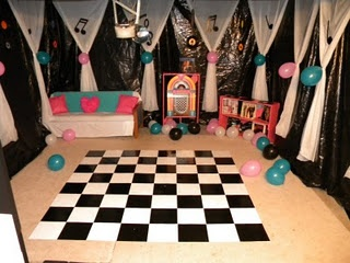 50's party-walls around the entire room draped curtains for entrance. themed pic on bathroom doors maybe room with food all purple?