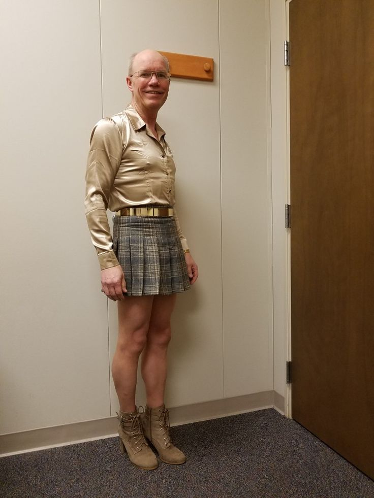 Brown and tan pleated mini skirt (AliExpress), gold silk satin shirt (AliExpress), gold metal belt (AliExpress), Hanes little color thigh high stockings, tan chunk high heel shoes (DSW).