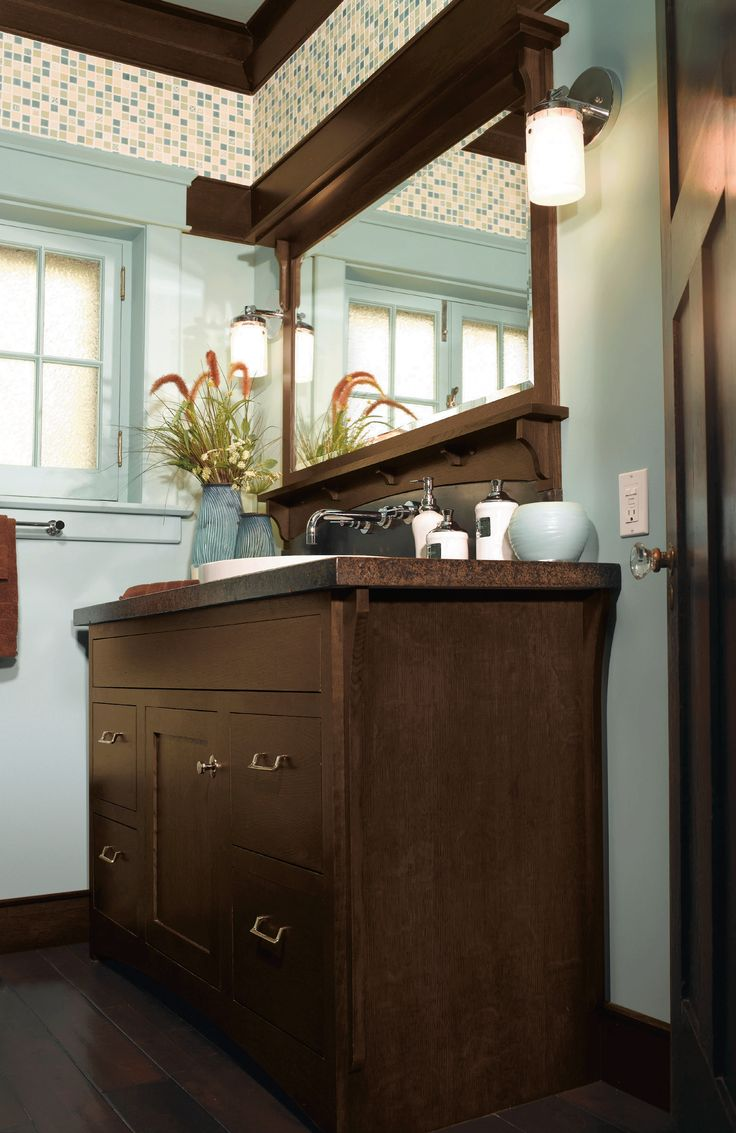 Photo On  charming paint color with traditional crown moulding and a rich vanity cabinet like this one by Omega Cabinetry for a fun and inviting bathroom design