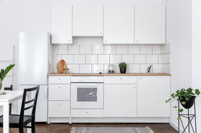 A Damp Smell In The Kitchen Cupboards That You Can T Quite Seem To Locate Could Be Due To A Water Leak In 2020 Clean Kitchen Cabinets White Appliances Stylish Kitchen