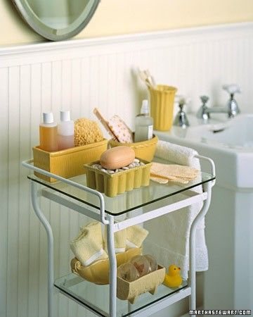 Vintage planters are a playful spin on more traditional bathroom accessories. Displayed on a metal-and-glass table, they hold bottles of shampoo and liquid soap, sponges, bar soap, and hand towels. Tuck a new toothbrush, soap, and a washcloth into a planter and put it in the bathroom cupboard -- you'll have the perfect guest package ready at a moment's notice.