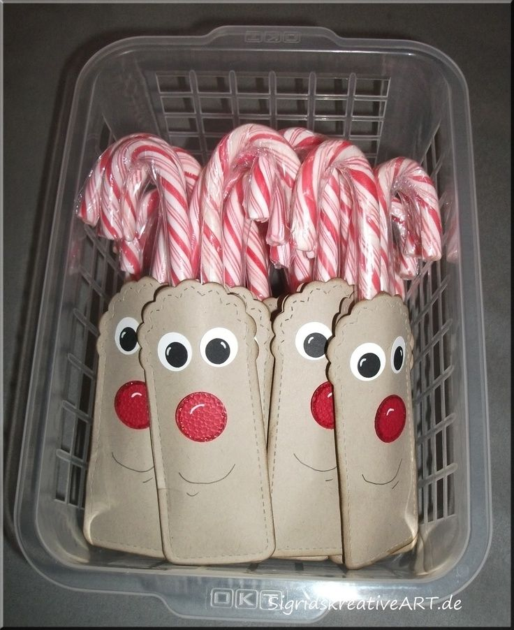 Reindeer activities: Reindeer treat bags. Cute & inexpensive way to give students a little something for Christmas.