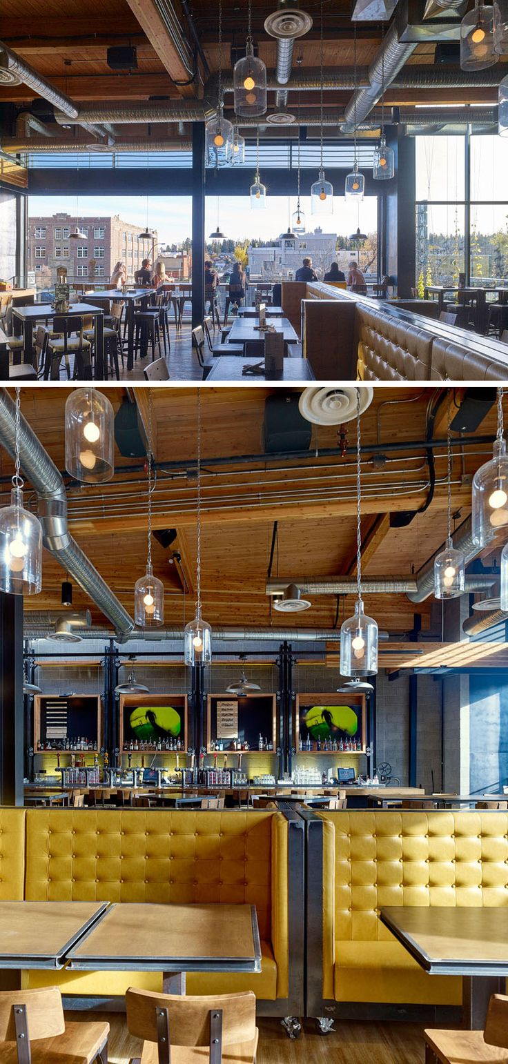 This industrial inspired brew pub design has the top floor open to a balcony that overlooks the street below. Inside, booth seating on wheels can be moved to change up the layout.