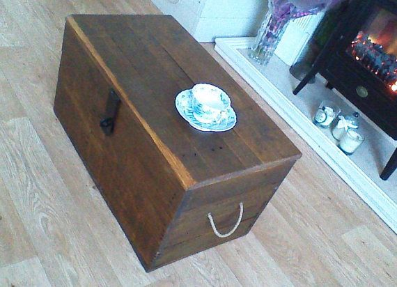 RECLAIMED RUSTIC SOLID PINE BLANKET BOX STORAGE CHEST OR LOCKABLE COFFEE TABLE This Charming Reclaimed Pine Storage Chest is made of Solid Pine in a dark stain with Jute Rope handles and a lockable metal latch and hinges. The Chest is made of reclaimed woods does have some natural imperfections like drying gaps, old nail holes, slight warps which just adds to the character or the piece, looks fabulous and makes a great blanket chest or storage coffee table. The chest is offered in ready to…
