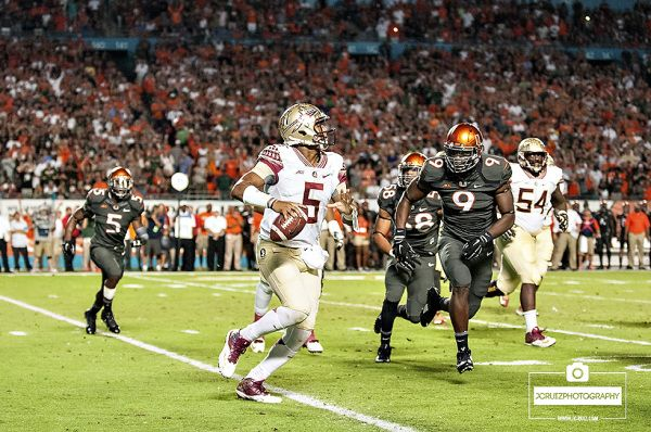 Florida State QB #5 Jameis Winston tries to evade Miami Hurricanes DE #9, Chad Thomas