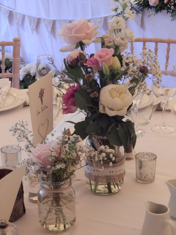 Wedding centre piece-English country garden flowers-roses, stocks and peonies in various mason jars with burlap and lace-beautiful for the setting.
