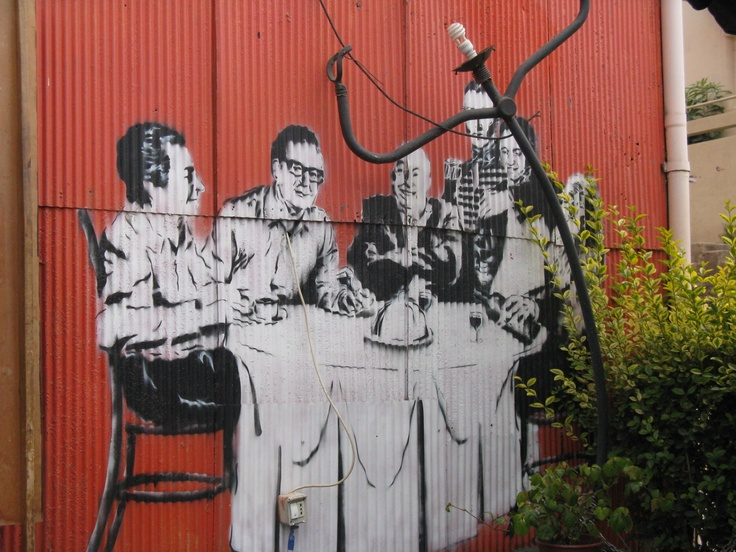 On the outside wall of someone's private home, well-known Chilean leaders (anachronistic) having lunch. (Allende, Neruda..) Valparaiso, Chile