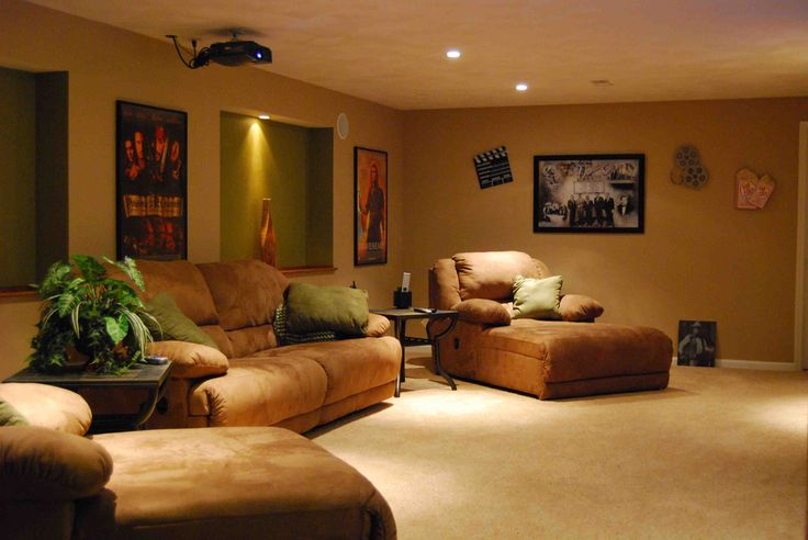 modern theater room style: outstanding movies poster and brown sofa in awesome home theatre room