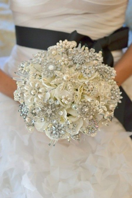 Beautiful and sustainable alternative to floral bouquets, a Brooch Bouquet. DIY tip: Collect brooches from family, thrift shops, and estate sales. Use a foam ball as the center and stick pins into it. Start with the big ones first and fill in with smaller ones.