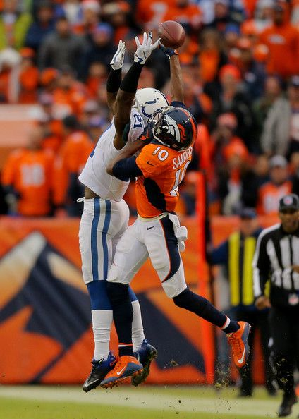 indianapolis colts win against Denver Brocos   Indianapolis Colts defends against Emmanuel Sanders #10 of the Denver ...