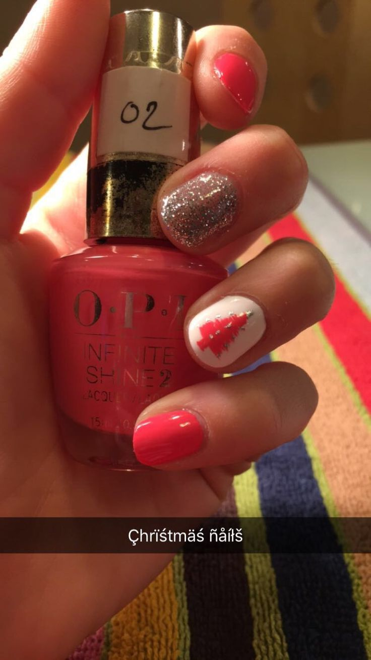 Christmas nails// pink maid with sparkle on ring finger and pink Christmas tree on ring finger