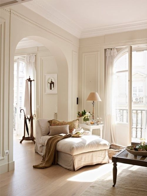 I love this room. Fabulous. The woodwork and moulding...the glimpse of a balcony. The comfy chaise lounge.