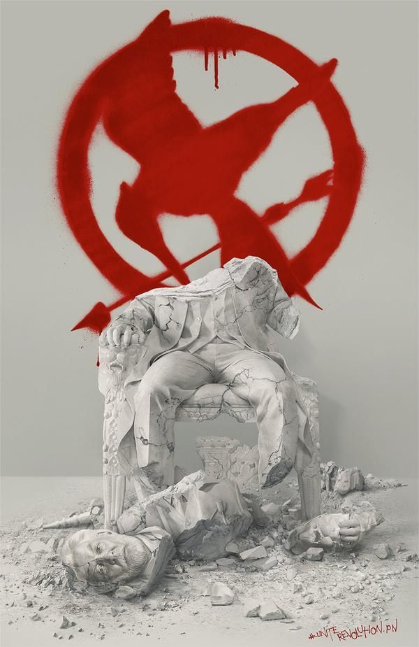 broken statue of President Snow / graffiti Mockingjay symbol