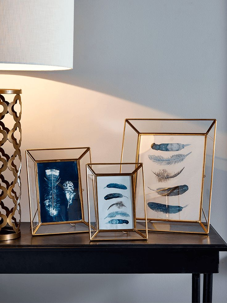 Crafted from glass with a delicate brass toned surround, our three brass frames are a beautiful way to display your favourite photographs, letters or pressed flowers. With a subtle geometric shape and portrait orientated stand, they will add a subtle metallic accent to your living space.