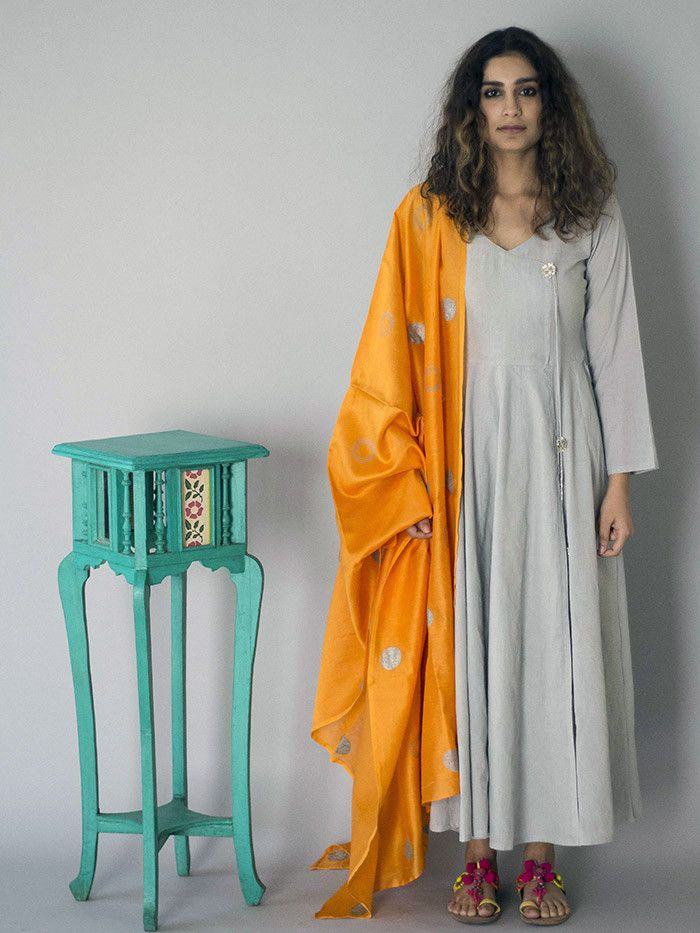 Description: This 3 piece set includes kurta, palazzo and dupatta. The dupatta is in pure chanderi with silver block printing. The cotton kurta is 50 inches in