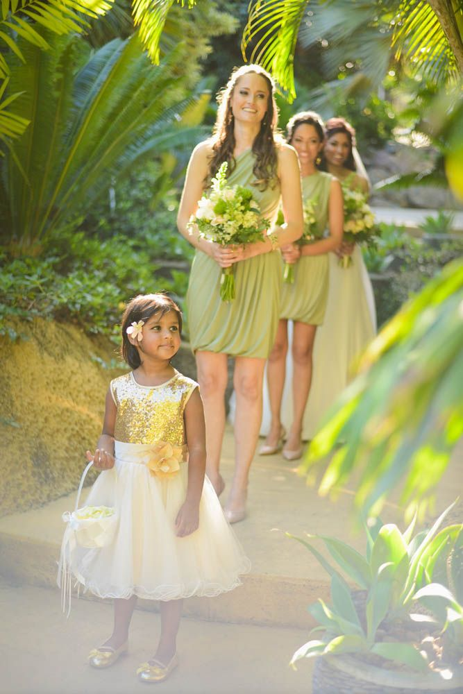 Beautiful golden highlights in the flower girls dress complete the colour scheme of Lava and Daniel's wedding day.
