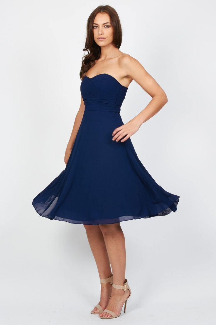 TFNC Party Dress<br /> <br /> - Bandeau style<br /> - Floaty pleated skirt<br /> - Midi length<br /> - Full skirt lining<br /> - Stretch band to the reverse<br /> - Chiffon fabric<br /> - Exposed zip to reverse<br /> <br /> Care: 100% Polyester. <br /> Hand Wash Only