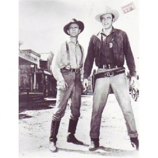 """US Marshal Matt Dillion and Chester in """"Gunsmoke"""" long running TV series in 1950s."""