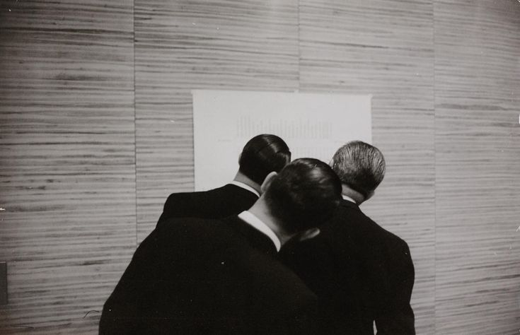 Three men in front of diagram - Rolf Gillhausen, ca. 1950.