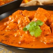 Lamb Rogan Josh: Lamb cooked with aroma of cinnamon, cardamom, bay leaves, turmeric, coriander and garam masala.